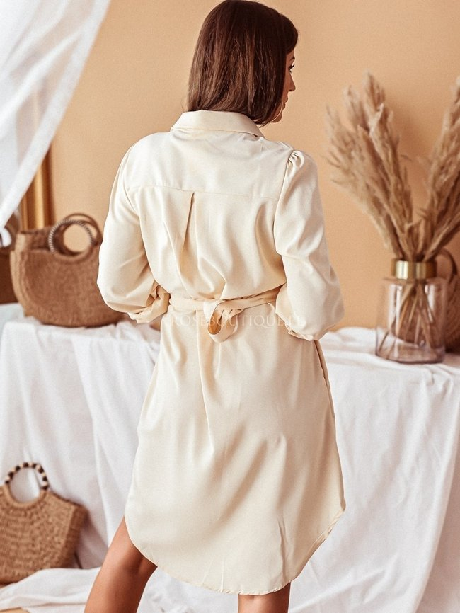 Apricot dress with a collar and puffy sleeves