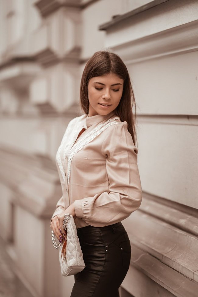 Beige blouse with long sleeves and openwork decorations