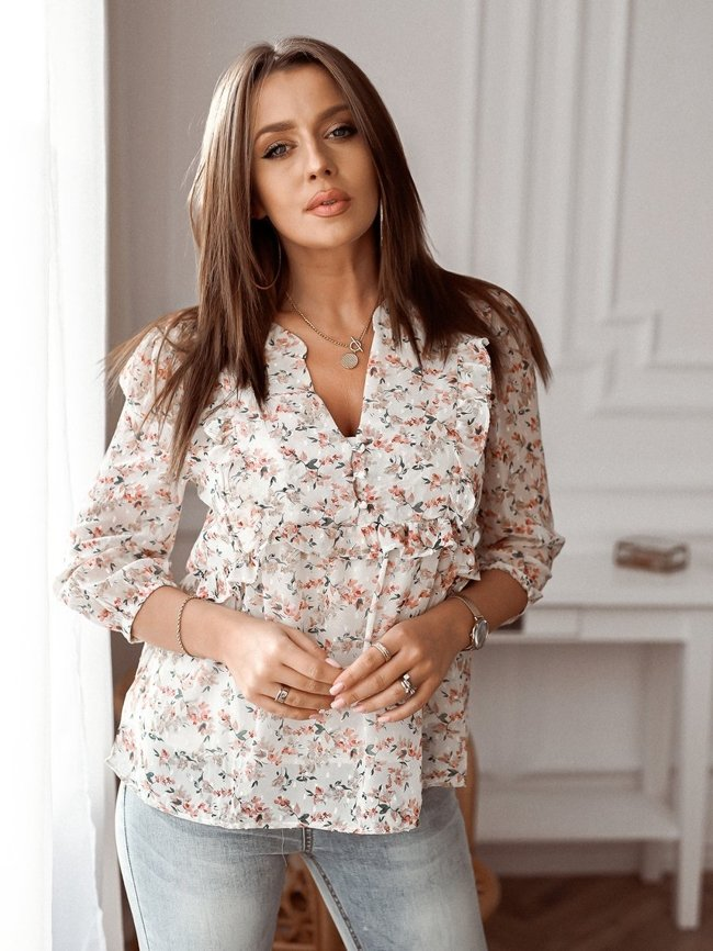 Beige floral blouse decorated with frills