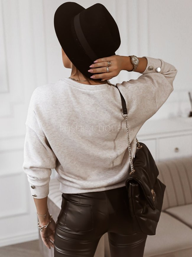 Beige sweater with a gold chain