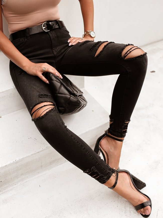 Black high waisted trousers with holes