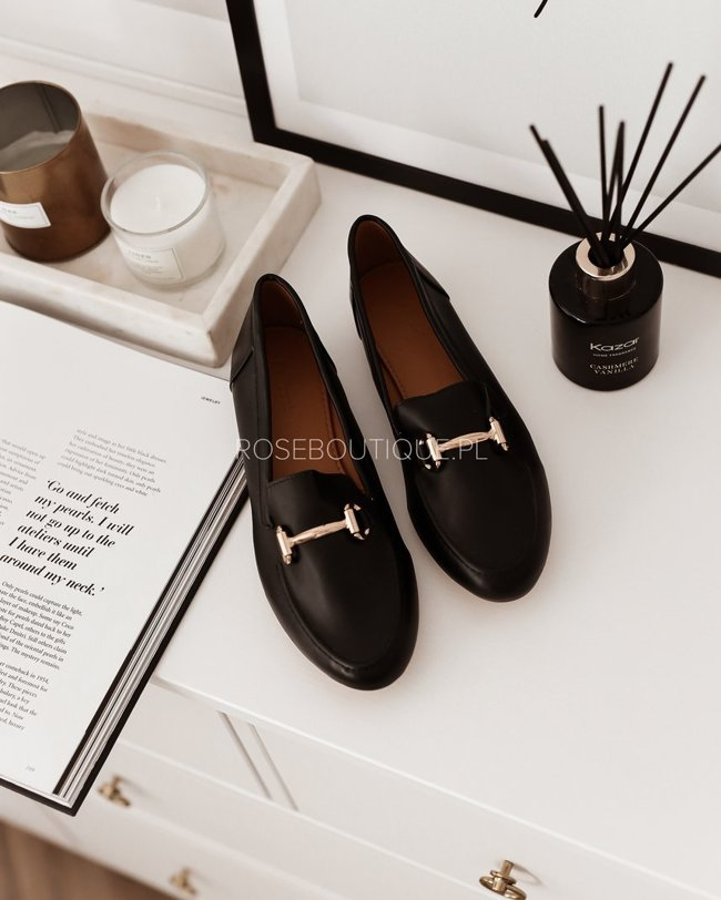 Black loafers with gold decoration