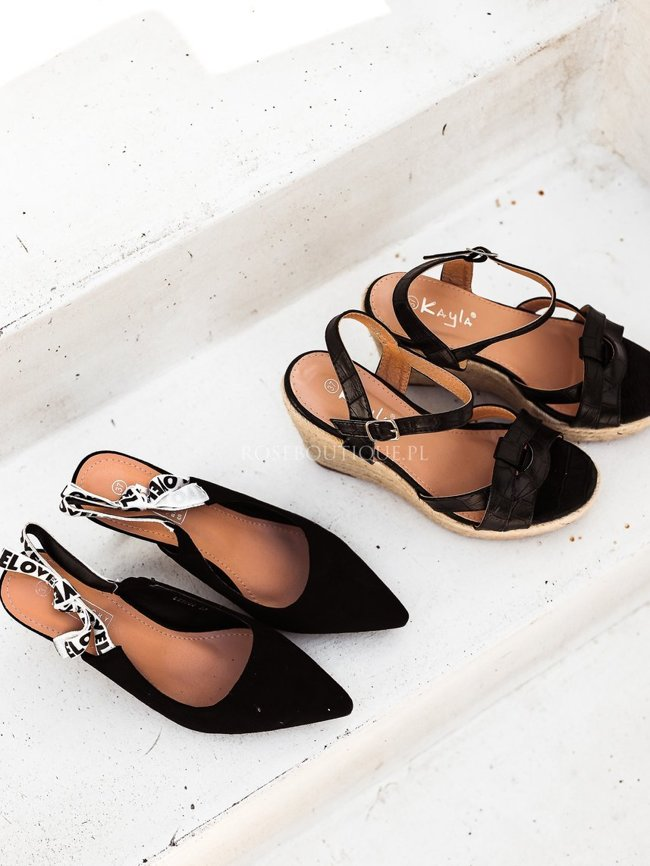 Black sandals on a wedge heel pattern