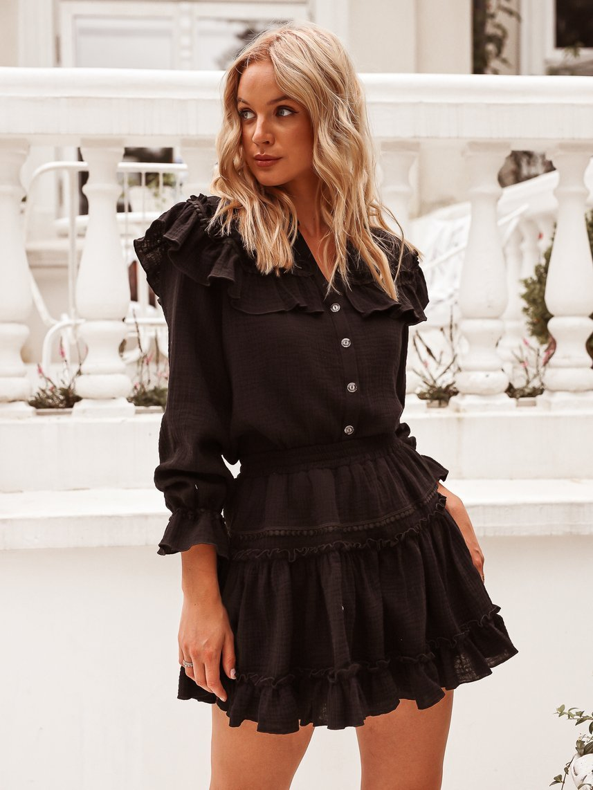 Black set of blouse with frill and skirt