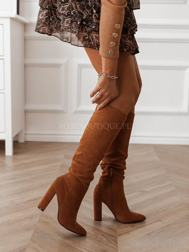 Caramel boots on a high post