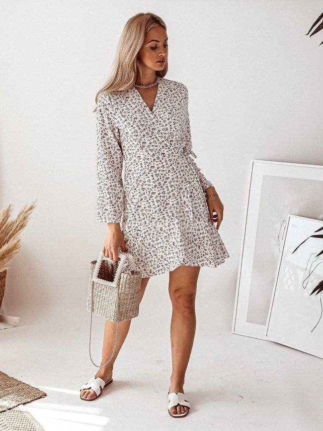 Cream tied dress in a small floral print