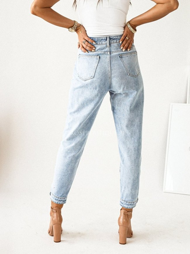 Mom jeans with decorative buttons