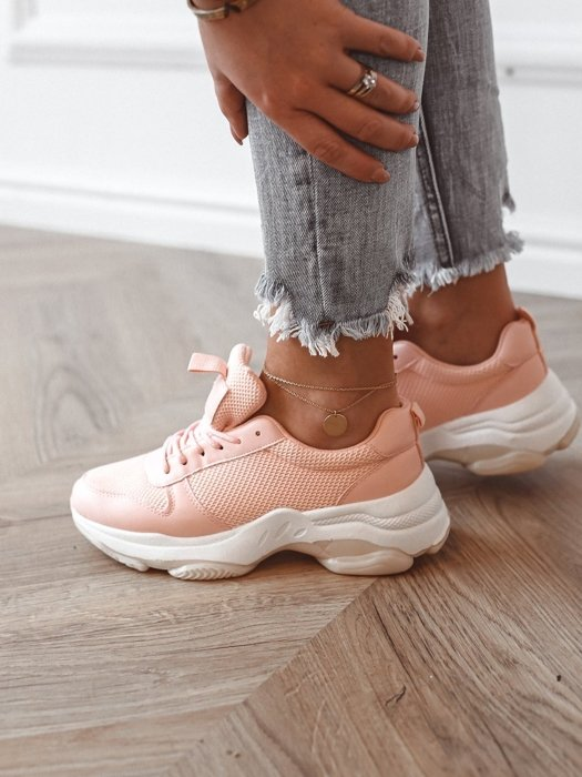 Pink sneakers with a cream sole