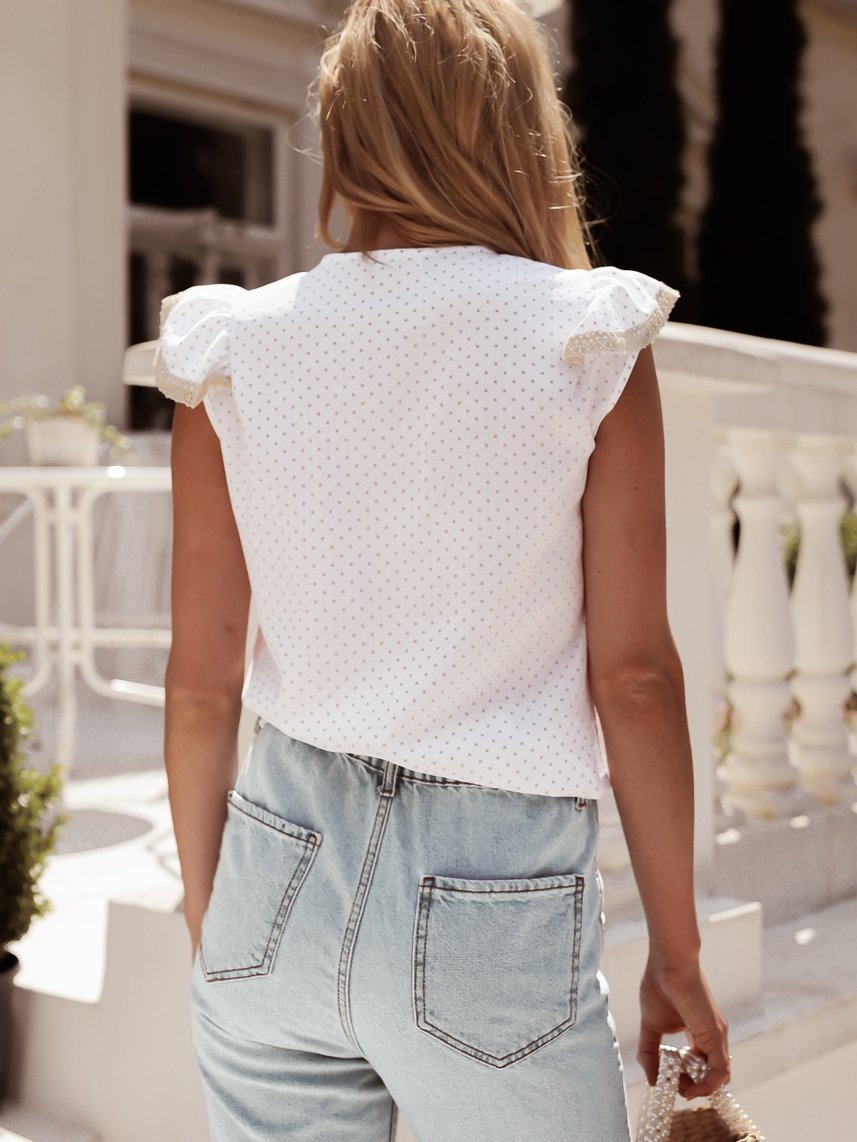 White blouse with a frill in small dots