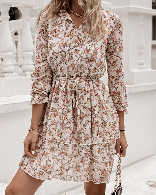 White dress with a delicate floral pattern