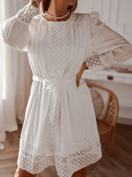 White elegant dress with openwork decoration
