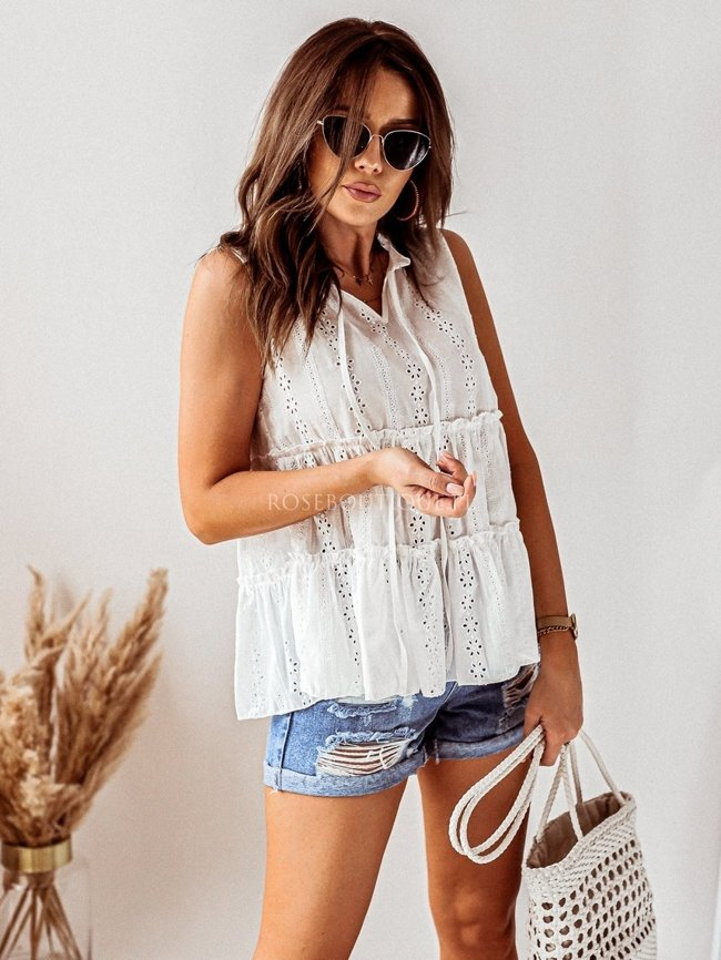 White openwork blouse with a tie and a frill