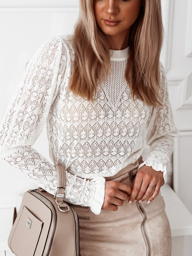 White openwork blouse with puffy sleeves with a frill