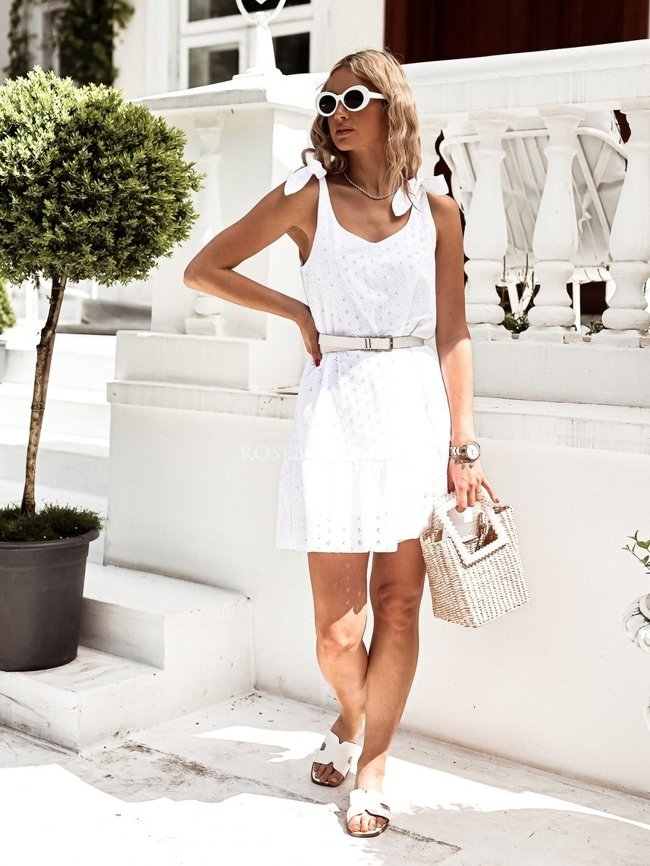White openwork dress with tied straps