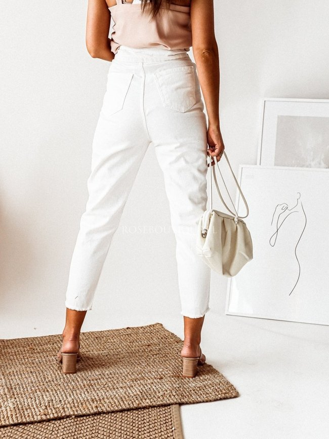 White pants with decorative clasp