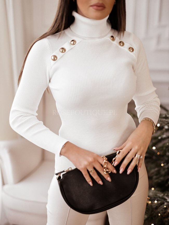 White ribbed turtleneck with golden embellishments