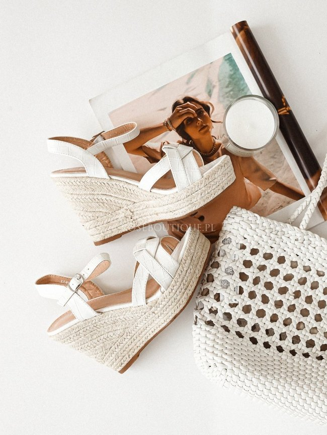White sandals on a wedge heel pattern