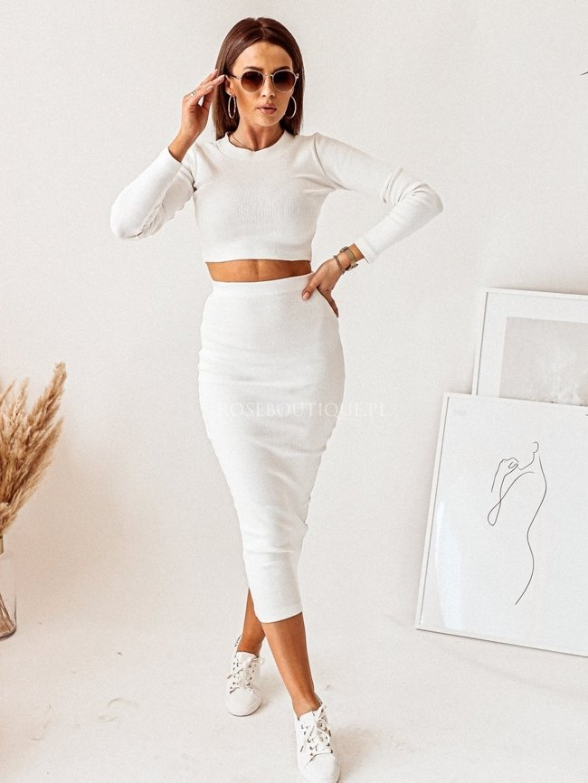 White set with long sleeves and a skirt