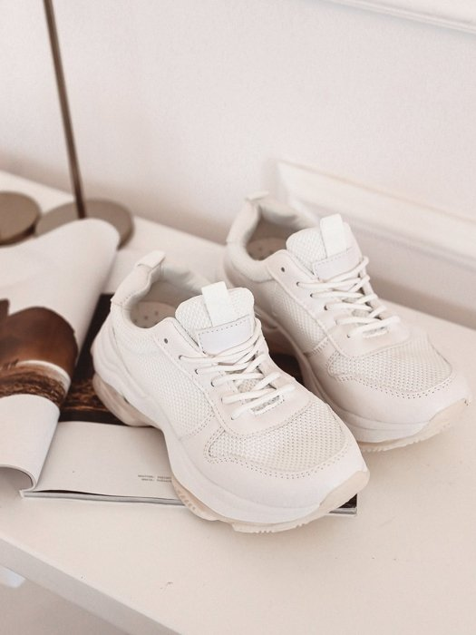 White sneakers with a cream sole