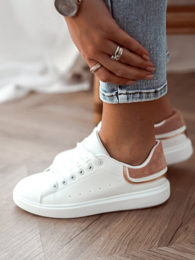 White sneakers with pink-gold decoration
