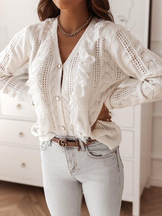 White sweater with a lace frill
