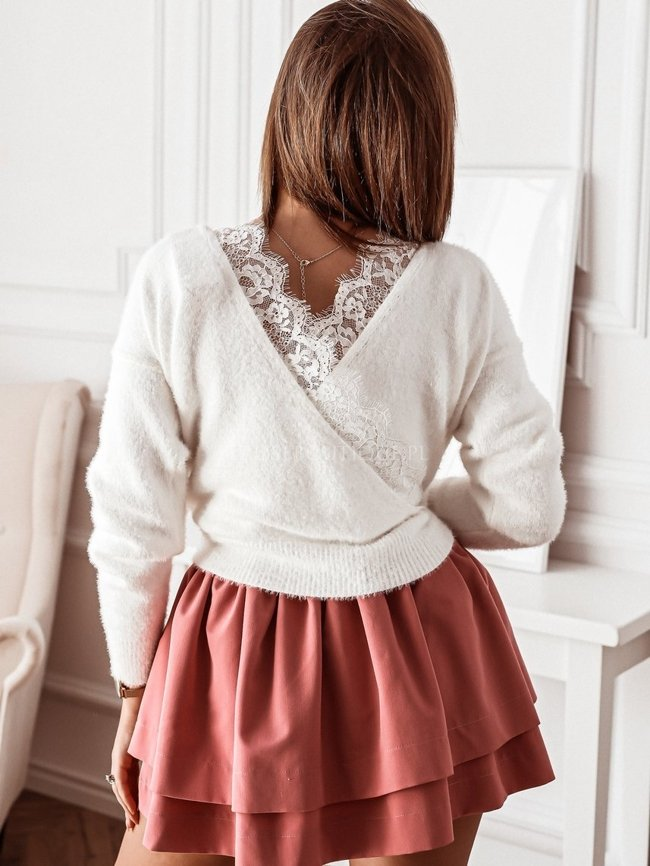White sweater with a lace neckline on the back