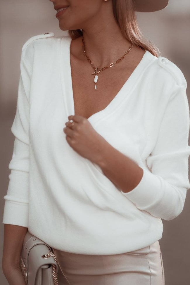 White sweater with a pleat