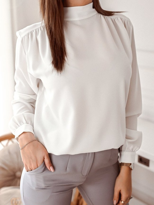 White tied blouse made of smooth material