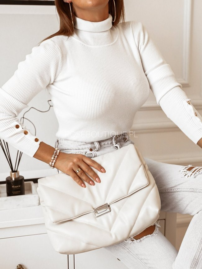 White turtleneck with decorative buttons